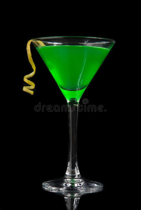 green cocktail black background green cocktail with absinth in martini glass for halloween