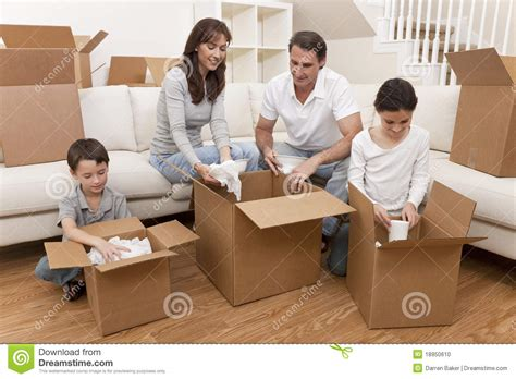 buying boxes for moving house family unpacking boxes moving house stock photo image
