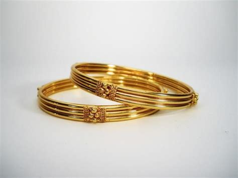 pattern of gold bangles pair of traditional gold bangles in kada pattern bangles