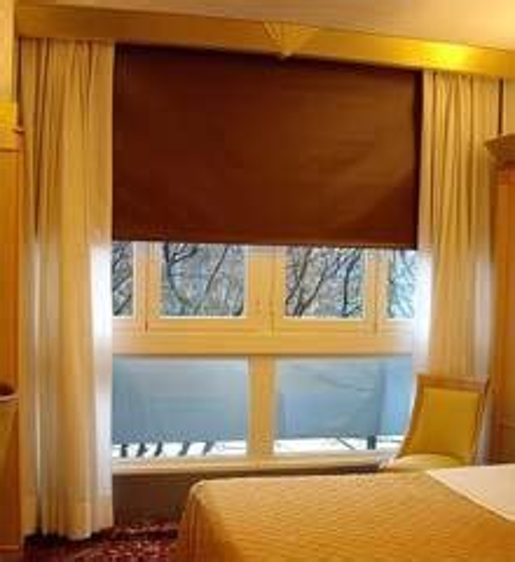 tende coprenti per finestre sistemi oscuranti