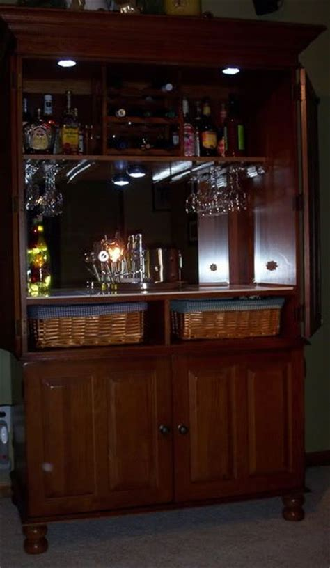 project convert tv armoire into bar for the home