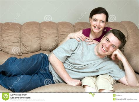 couple on couch couple relaxing on the couch together horizontal royalty
