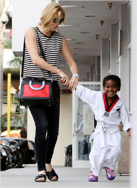 Charlize Therons All Smiles As Shelked Hand In Hand