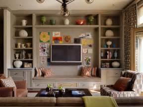 family room shelving tv built ins transitional living room burnham design