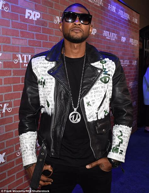 ushers tattoo on his hand usher gets new mystical tattoo on his throat daily mail