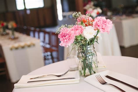 wedding reception centerpieces with jars pink and white carnations in jars for wedding