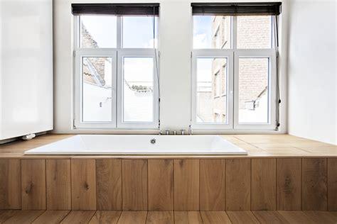 badkamermeubel hout en staal hout en staal in de badkamer van een loft in antwerpen