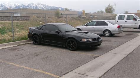 black mustang w white wheels aka unicorn the