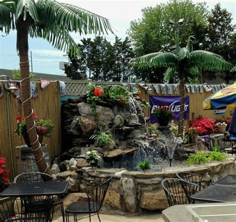 patio and tiki bar picture of city grille manassas