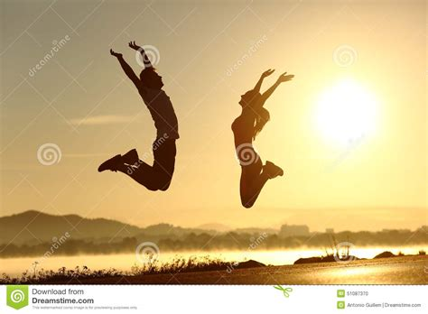 happy pictures fitness jumping happy at sunset stock photo image 51087370