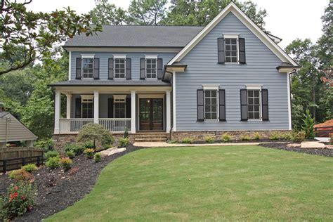 earth tone exterior house colors exterior style with large house two chimneys
