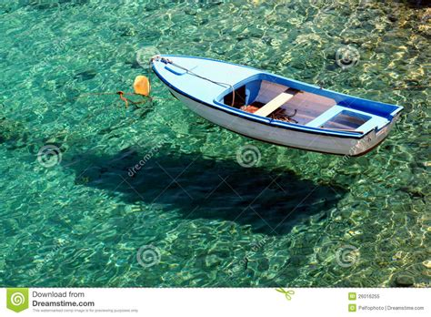 flex tape clear boat boat on crystal clear sea royalty free stock photo