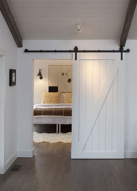 sliding door for bedroom rustic bedroom sliding barn door ideas frances hunt