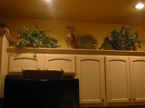 decorations for top of kitchen cabinets kristen s creations decorating kitchen cabinet tops