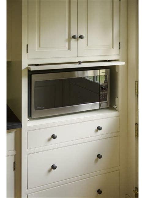 pocket doors in kitchen cabinetry perfect for hiding a tv hide microwave or toaster oven kitchen pinterest