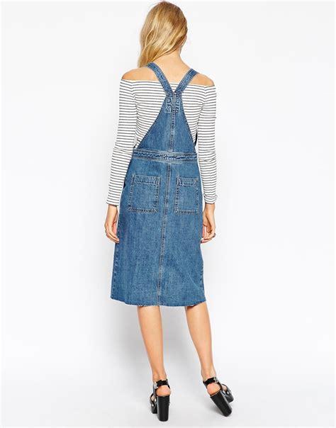 Pinafore Midi Denim Dress asos denim midi pinafore dress with hem in blue lyst