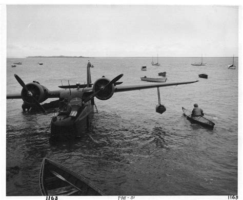 retro photos file bow of plane and eskimos in kayaks vintage old photo