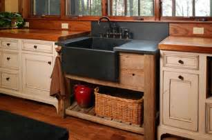 Rustic Kitchen Sink This Rustic Kitchen Has A Stand Alone Farmhouse Sink In Black Sitting On A Wooden Base