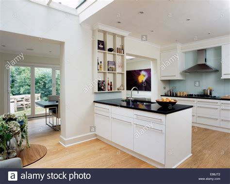 white kitchen black worktop black granite worktop on peninsular unit in modern white