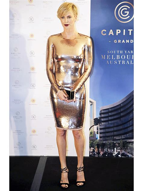 Mag Cover Fashion Faceoff Charlize Vs Kate by Charlize Theron Wears A Tight Gold Minidress At Hong Kong
