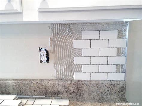 how to lay tile backsplash in kitchen how to install a backsplash the budget decorator