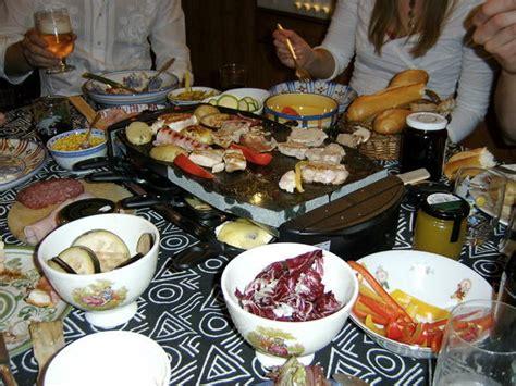 raclette dinner dinner around the raclette photo