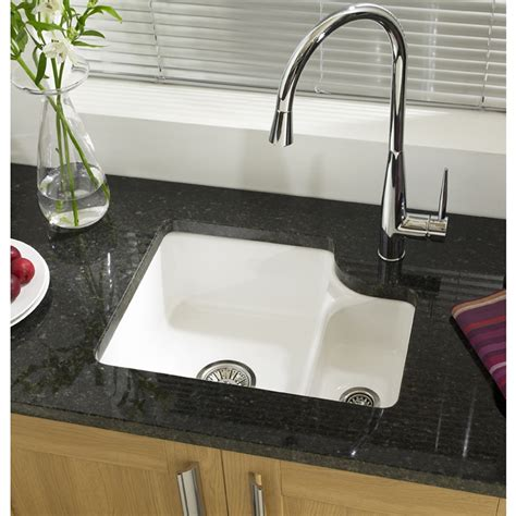 white ceramic single undermount kitchen sinks on granite
