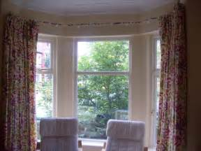And allows the curtains to hang under the track just like curtains