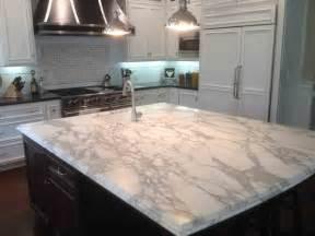 kitchen kitchen island with white quartz countertop and