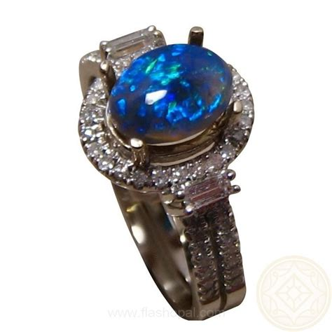 semi black opal ring blue oval flashopal