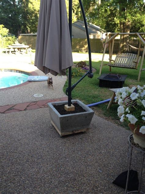 Diy Patio Umbrella Stand How To Build A Patio Umbrella Stand Planter Diy Projects For Everyone