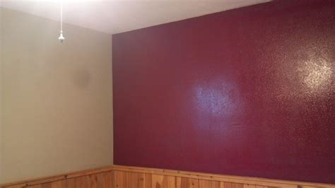 large basement bedroom repainted khaki with burgundy accent wall decor accent
