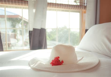 hat on the bed belize vacation 10 things to know before you take off