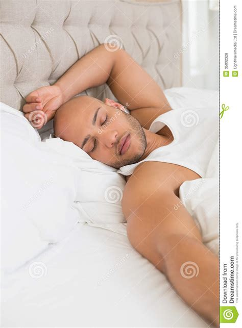 man sleeping in bed young man sleeping in bed royalty free stock photos