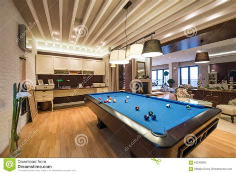pool table in living room interior of a luxury living room with pool table stock