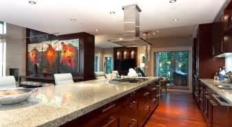 The penthouse s kitchen filled with gourmet appliances custom wood