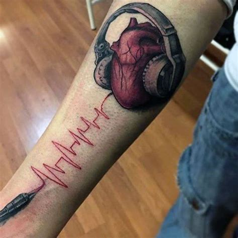 heartbeat headphones tattoo heartbeat and heart with headphones tattoo guys forearms