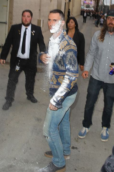 adam levine flour bombed outside jimmy kimmel live or adam levine hit in the face with flour bomb outside jimmy
