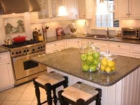 White kitchen cabinets white tile granite tile countertops dark