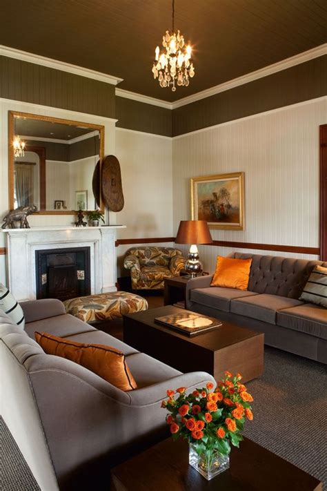 burnt orange and brown living room warm colors and two tones on
