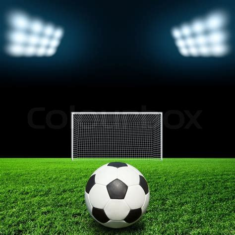 A Frame Home Plans by Soccer Ball On Grass Against Black Background Stock