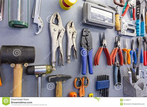 assorted work tools on garage wall stock photo image
