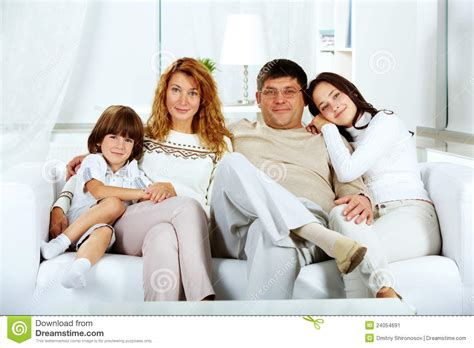 family sofa family on sofa stock image image 24054691