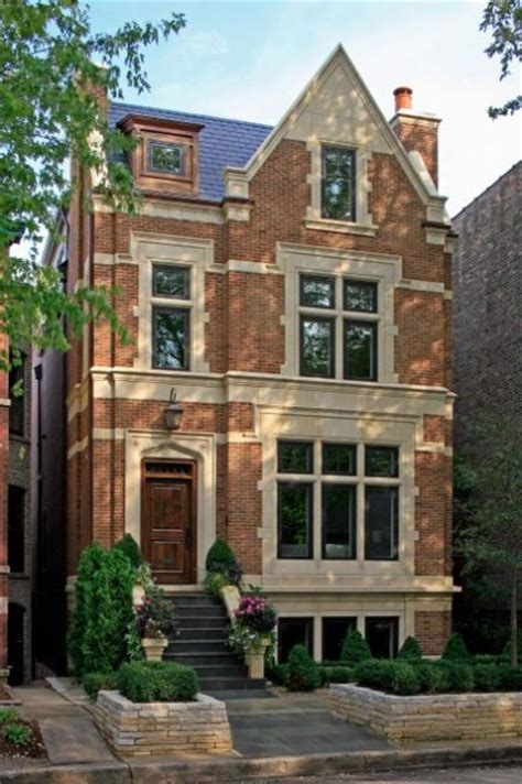 style brick and limestone townhouse in the leafy