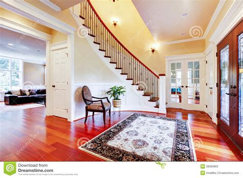 house and home luxury home entrance with cherry hardwood floor and