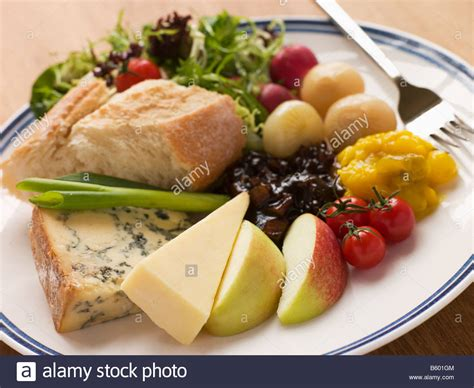 stilton and stilton and cheddar ploughman s stock photo