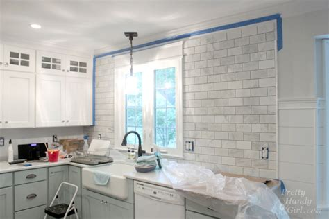 how to put up tile backsplash in kitchen how to install a tile backsplash setting pretty handy girl