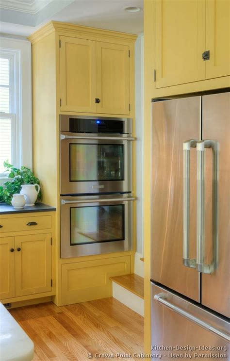 double oven kitchen cabinet traditional yellow kitchen with a custom wood island