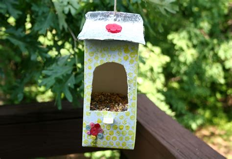 how to make a diy milk carton bird feeder inhabitots
