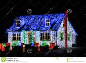 houses with a lot of lights lights show display on house at stock